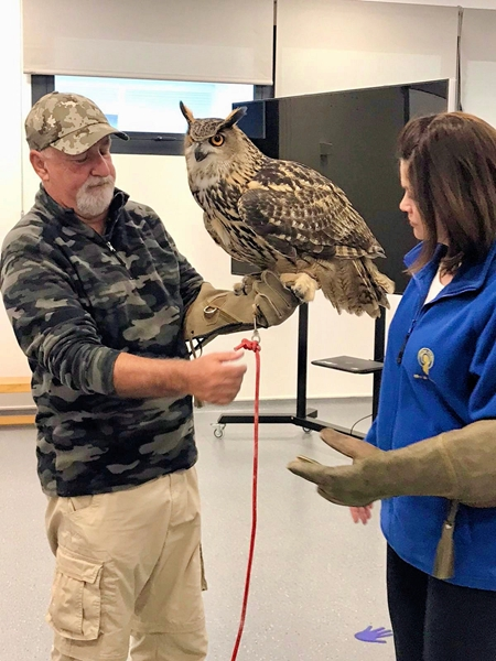 Vincent showing the teacher how to hold the Eagle Owl